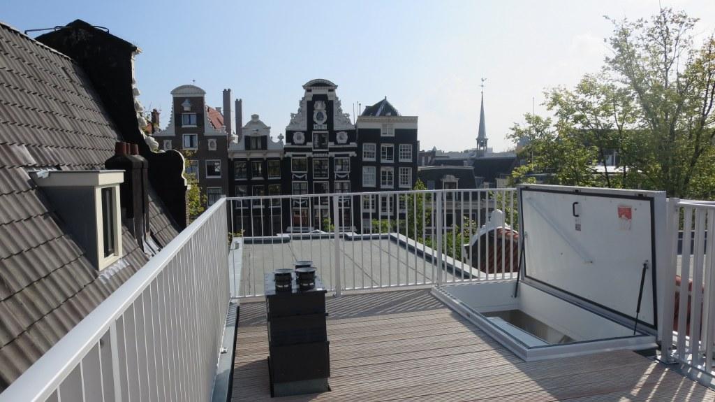 Omgevingsvergunning dakterras Amsterdam West en Zuid.